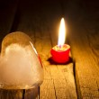 Ice heart and candle abstract Valentine s Day concept in night — Stock Photo