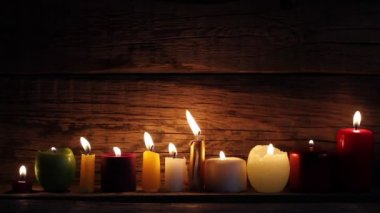 Candles in night in romantic mood on vintage wooden boards — Stock Video