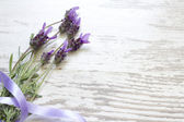 Lavender flowers on vintage wooden boards background — Stock Photo