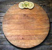 Old vintage cutting board abstract food background — Photo