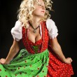 Dancing girl in typical bavarian dress dirndl — Stock Photo
