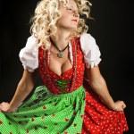 Dancing girl in typical bavarian dress dirndl — Stock Photo