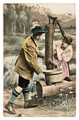 Funny flirting couple in typical bavarian tracht dress — Stock Photo