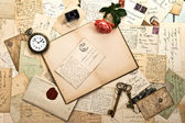 Open book, roses flower, and old post cards — Stock Photo
