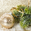 Golden christmas ball with christmas tree branch — Stock fotografie