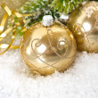Golden christmas ball with christmas tree branch — Stock Photo