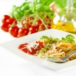 Spaghetti pasta with tomato sauce, fresh basil and grated parmes - Stock Photo