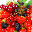 Stock Photo: Assorted fresh berries on white