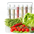 Vegetables and spices on kitchen table — Stock Photo #13396593