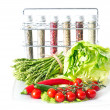 Vegetables and spices on kitchen table — Stock Photo #13396619