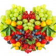 Heart shape of mixed berries and fruits — Stock Photo