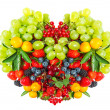 Heart shape of mixed berries and fruits - Stock Photo