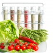 Vegetables and spices on kitchen table — Stock Photo #13397335