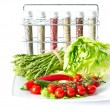 Vegetables and spices on kitchen table — Stock Photo #13397346