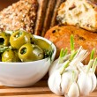Olives and garlic with tasty Italian bread - Stock fotografie
