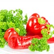 Red paprica with green parsley — Stock Photo