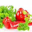 Red paprica with green parsley - Stock fotografie