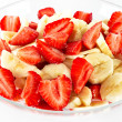 Strawberries and banana slices — Stock Photo