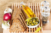 Tasty grain bread with olives and spices — Stock Photo