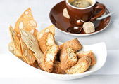 Italian almond cookies cantuccini and black coffee — Stock Photo
