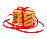 Christmas cookies with red ribbon — Stock Photo