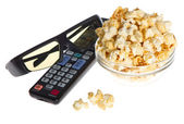 3d glasses, tv remote control and popcorn — Stock Photo