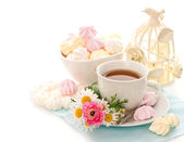 Cup of tea with flowers and sweets — Stock Photo