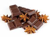 Dark chocolate and star anise — Stock Photo