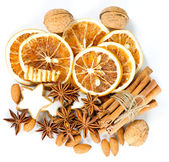 Cinnamon sticks, anise stars, nuts and sliced of dried orange — Stock Photo