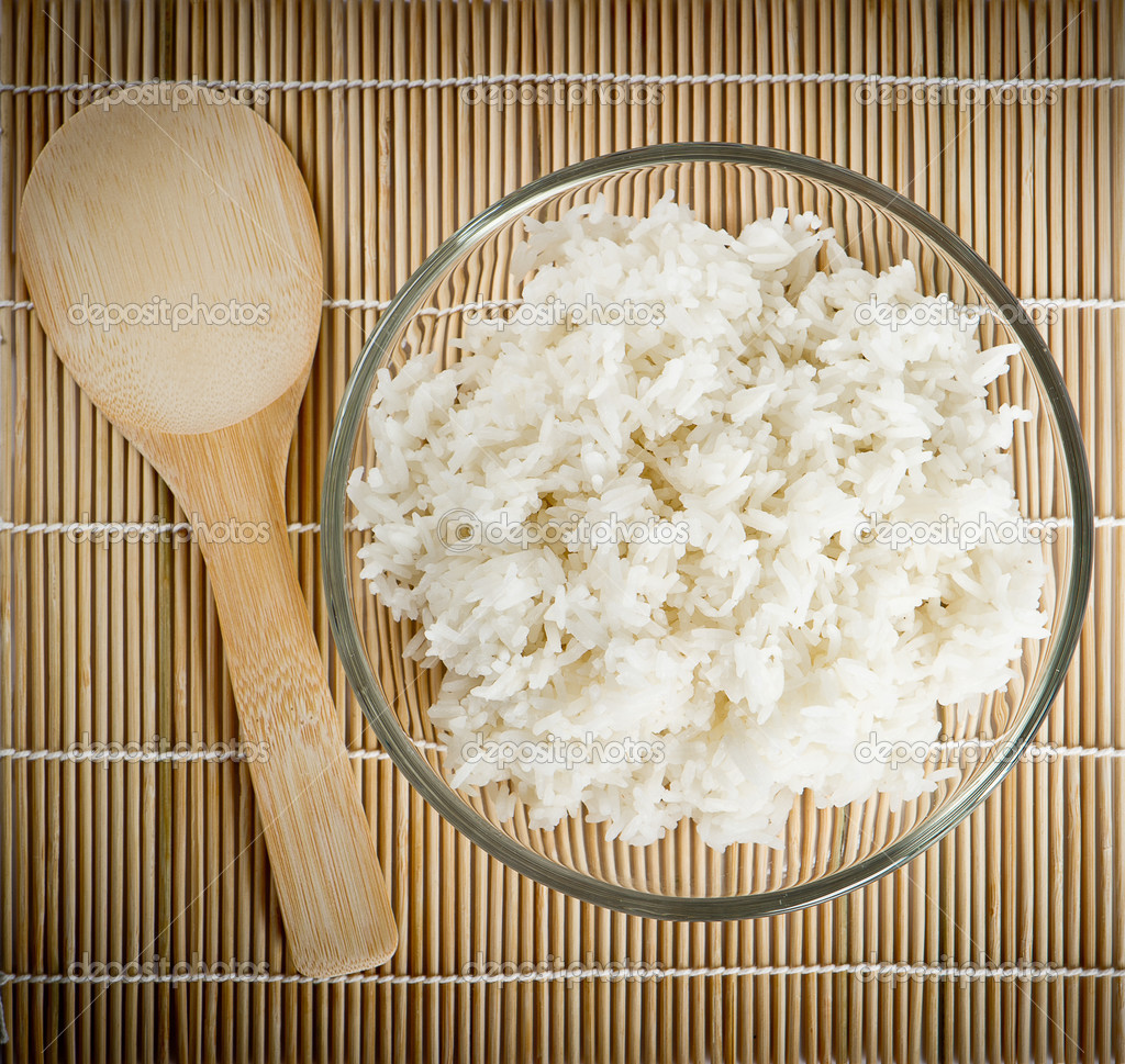 White steamed rice on bamboo background — Stock Photo #13398365