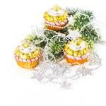 Colorful cupcake as christmas tree decoration. silver garland — Stock Photo