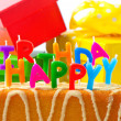 Happy birthday. birthday cake with letter candles and gifts — Stock Photo #13403526