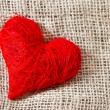Red heart on burlap background — Stock Photo
