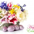 Tulips, narcissus and hyacinth and easter eggs - Stock Photo
