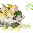 Fresh pastel colored tulips in the basket with easter eggs decor — Stock Photo
