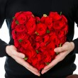 Red roses. flowers bouquet in heart shape — Stock Photo