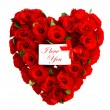 Red heart of roses with white card — Stock Photo
