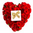 Heart of red roses with a gift box — Stock Photo