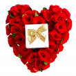 Stock Photo: Heart of red roses with a gift box