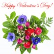 Colorful flowers bouquet in heart shape - Stock Photo