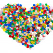 Confetti in heart shape. colorful background — Stock Photo