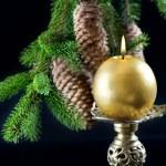 Christmas tree and burning candle — Stock Photo