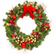 Christmas wreath with red ribbon and golden decoration — Stock Photo #13406500