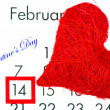 Red heart over calendar - Stock Photo