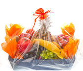 Assorted fruits in the box with decoration — Stock Photo
