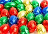 Chocolate easter eggs in colorful foil — Stock Photo