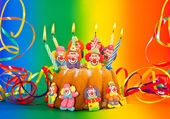 Birthday cake with candles and streamer — Stock Photo