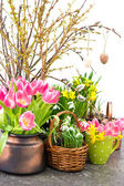 Flowers and fresh tree twigs with easter eggs — Stock Photo