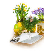 Festive easter table setting with eggs and flowers decoration — Stock Photo