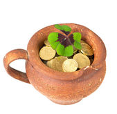 Ceramic pot with money coins and clover leaf — Stock Photo